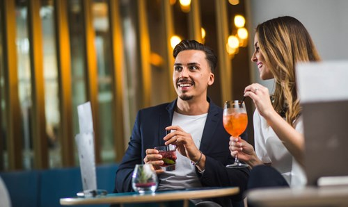 Couple enjoying cocktails at Apex City of Bath Hotel