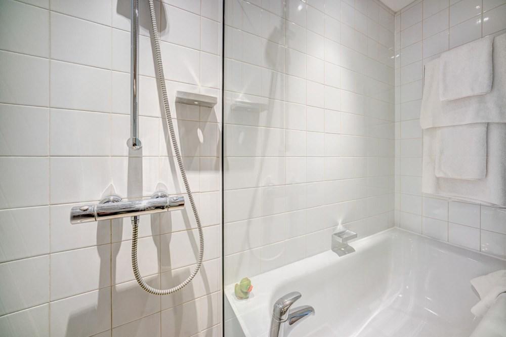 Family Room bathroom walk-in shower at Apex City of Edinburgh Hotel