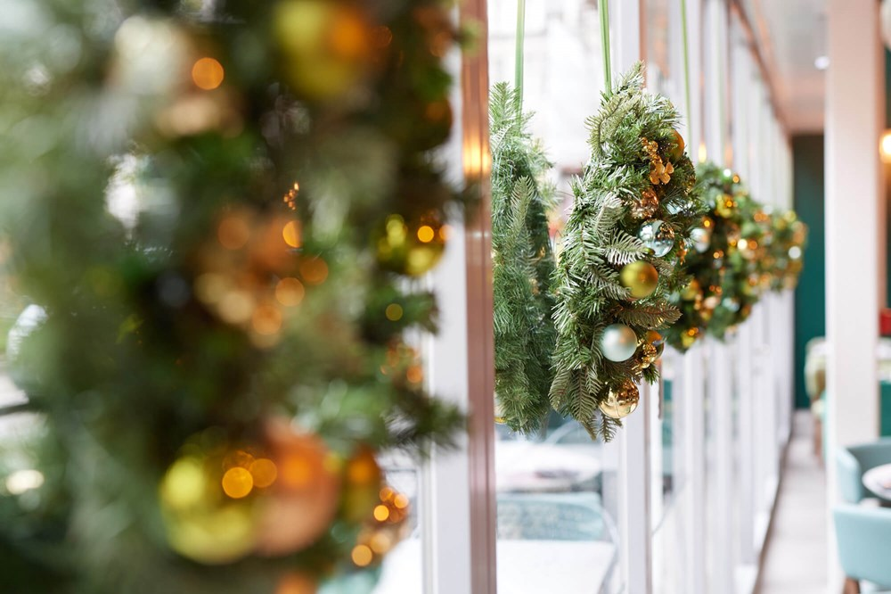 Christmas wreaths with gold decorations on windows at Apex City of London Hotel