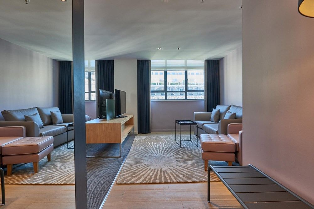 Deluxe Room living area at Apex City of London Hotel