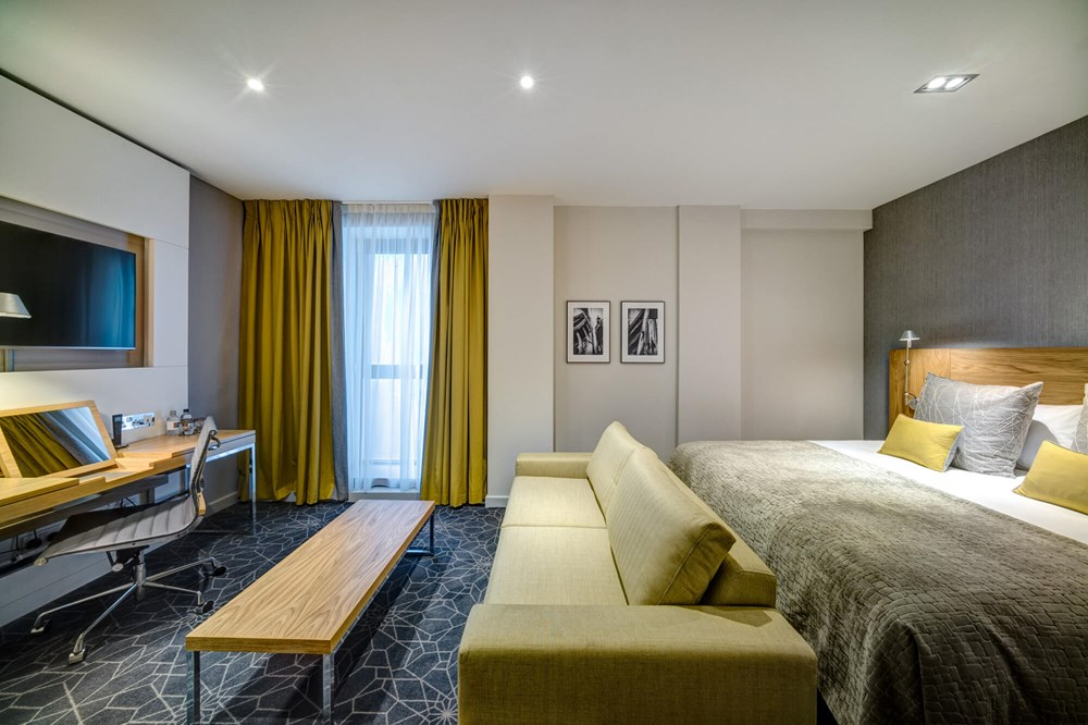 Family Room with double bed and sofa bed at Apex City of Glasgow Hotel