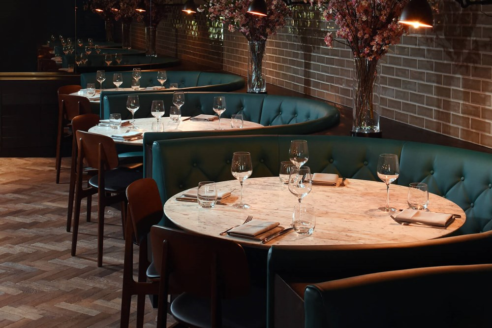 Tables set for dining at The Lampery at Apex City of London Hotel