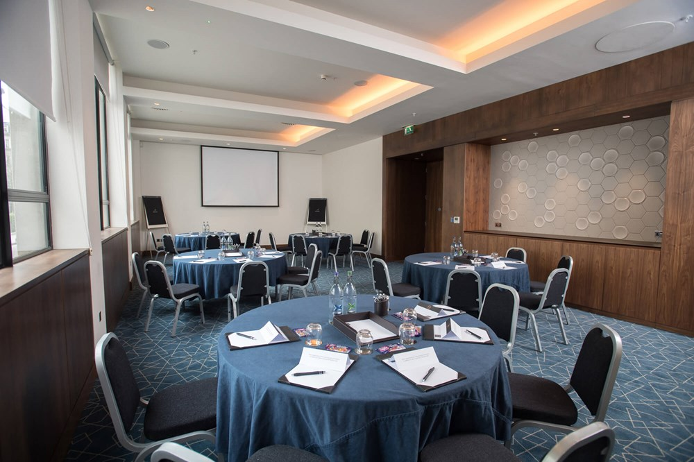 City Suite in Apex City of London Hotel set for private meeting/conference with notepads on round tables