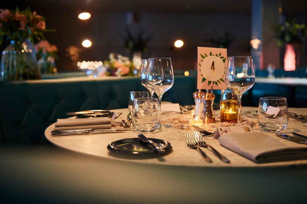 Table set for private dinner with white tablecloth