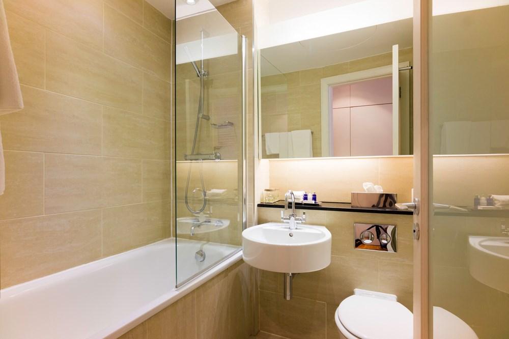 City Room bathroom with bath at Apex Haymarket Hotel