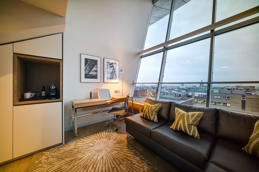 Duplex Suite lounge with daytime city view