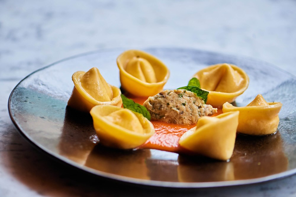 Burrata tortelloni with tomato fondue, aubergine and basil