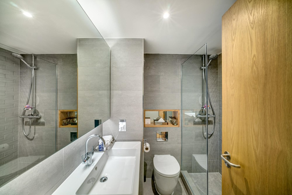 Family Room bathroom with walk-in shower and sink
