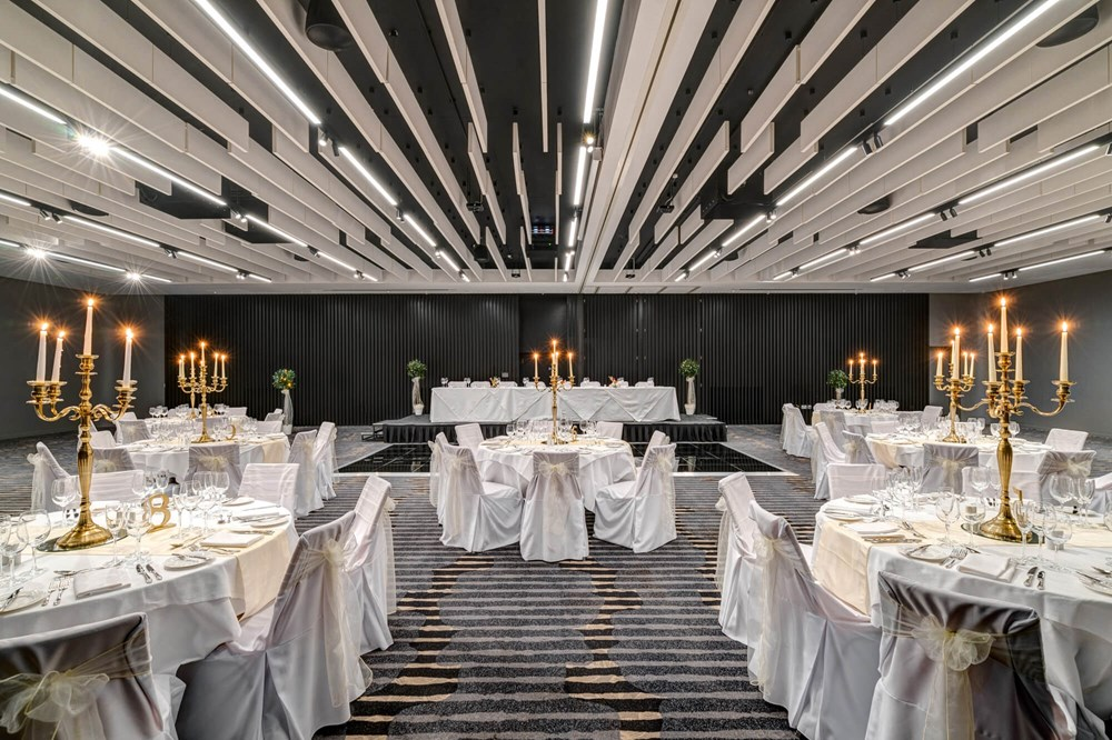 Lansdown Suite set for wedding with white tablecloths and gold candles