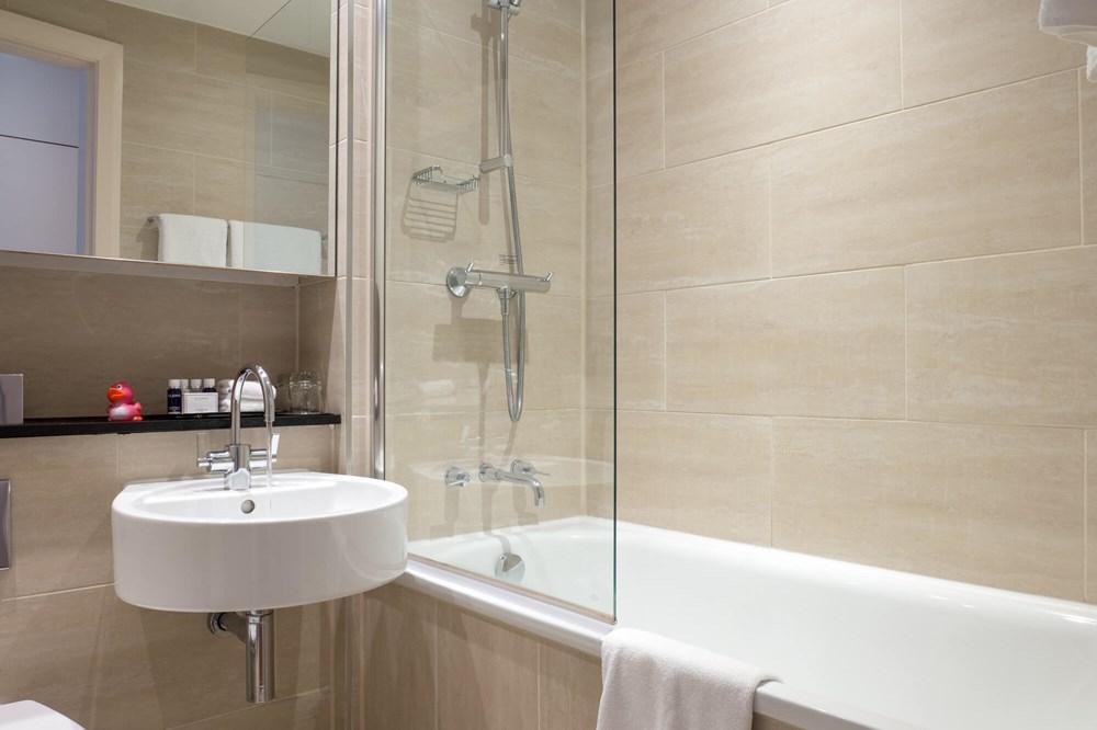 City Plus Room bathroom with bath at Apex Haymarket Hotel