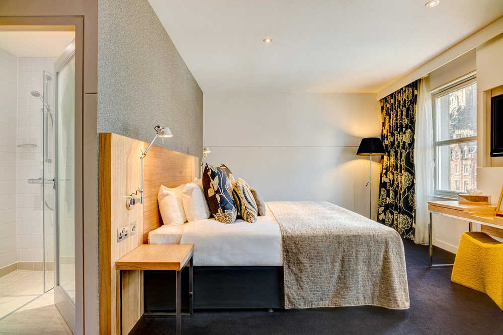Master Suite bedroom with king-size bed at Apex City of Edinburgh Hotel