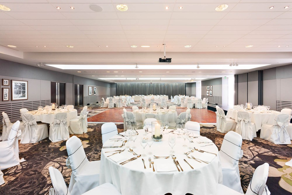 City Quay Suite set up for wedding with round tables and white tablecloths