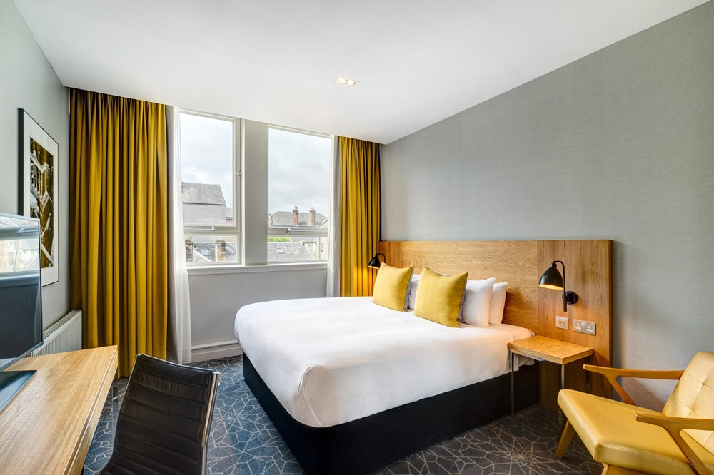 City Room with queen-size bed and desk at Apex Grassmarket Hotel