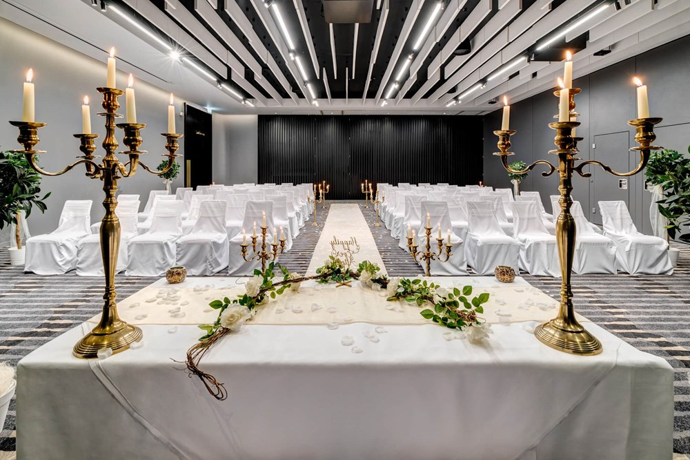 Lansdown Suite set for wedding with aisle and gold candles