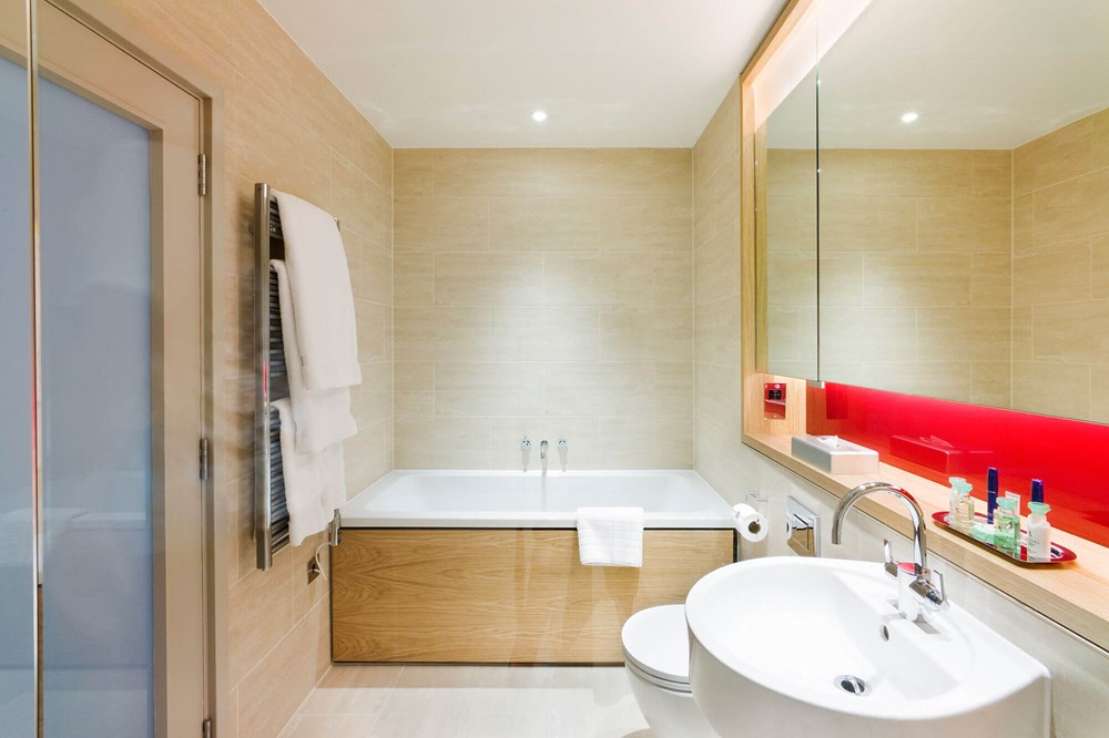Bathroom with bath in Junior Suite at Apex Temple Court Hotel
