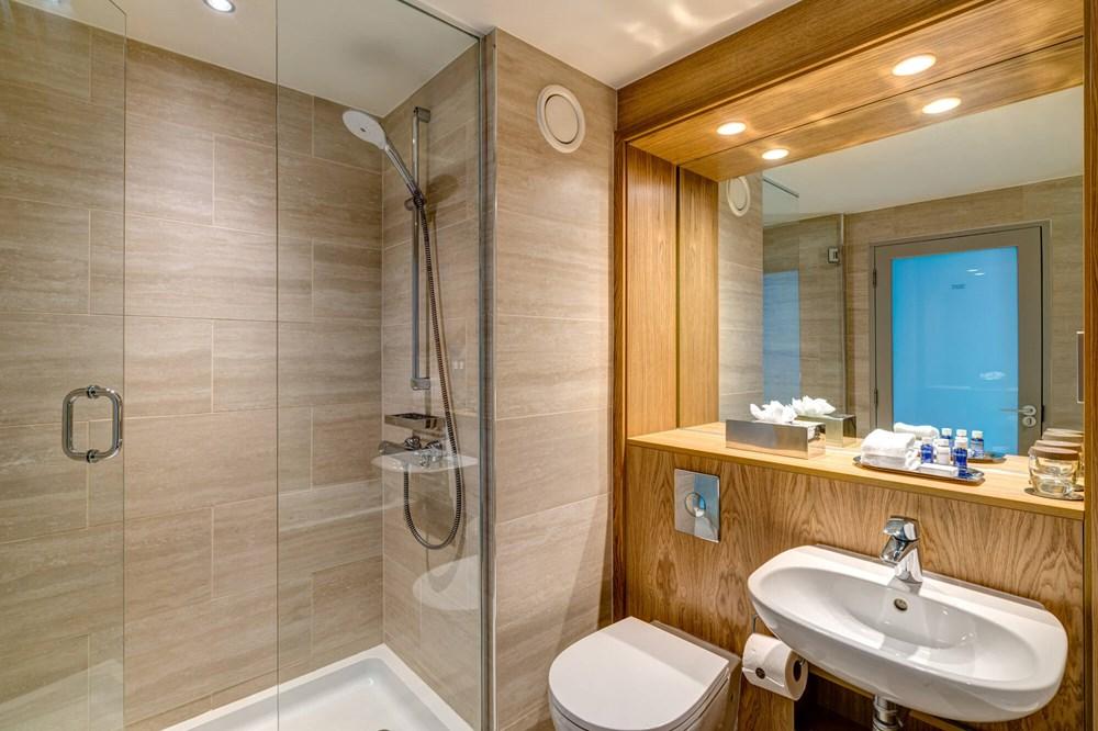 Walk-in shower next to sink in bathroom