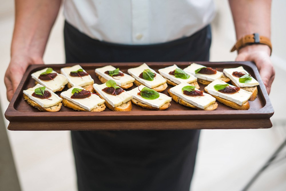Waiter holding tray of canapes