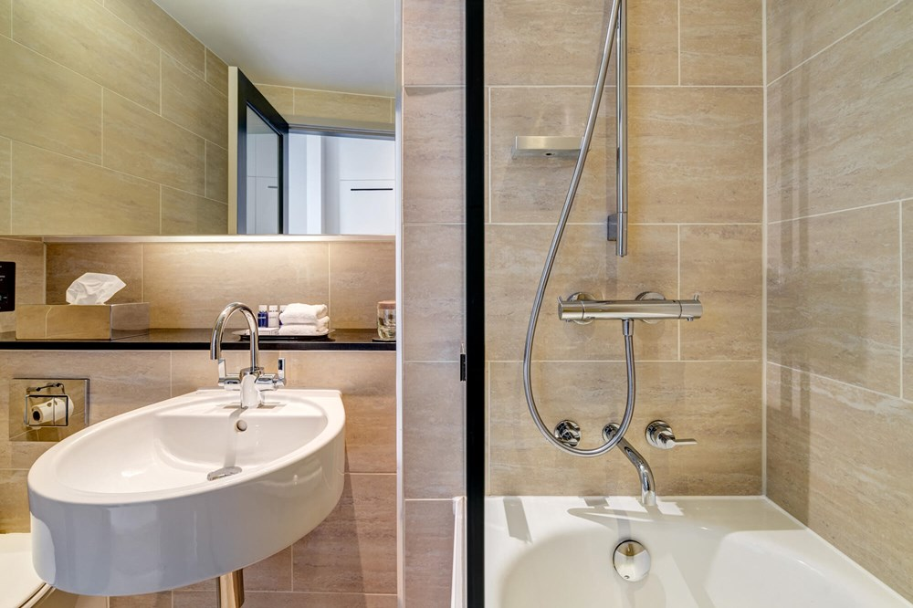 City Room bathroom with shower over bath at Apex Grassmarket Hotel