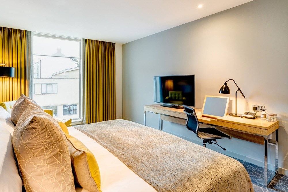 Superior Room with king-size bed and TV on desk