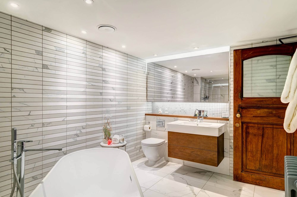 Grand Suite bathroom with freestanding bathtub at Apex Temple Court Hotel