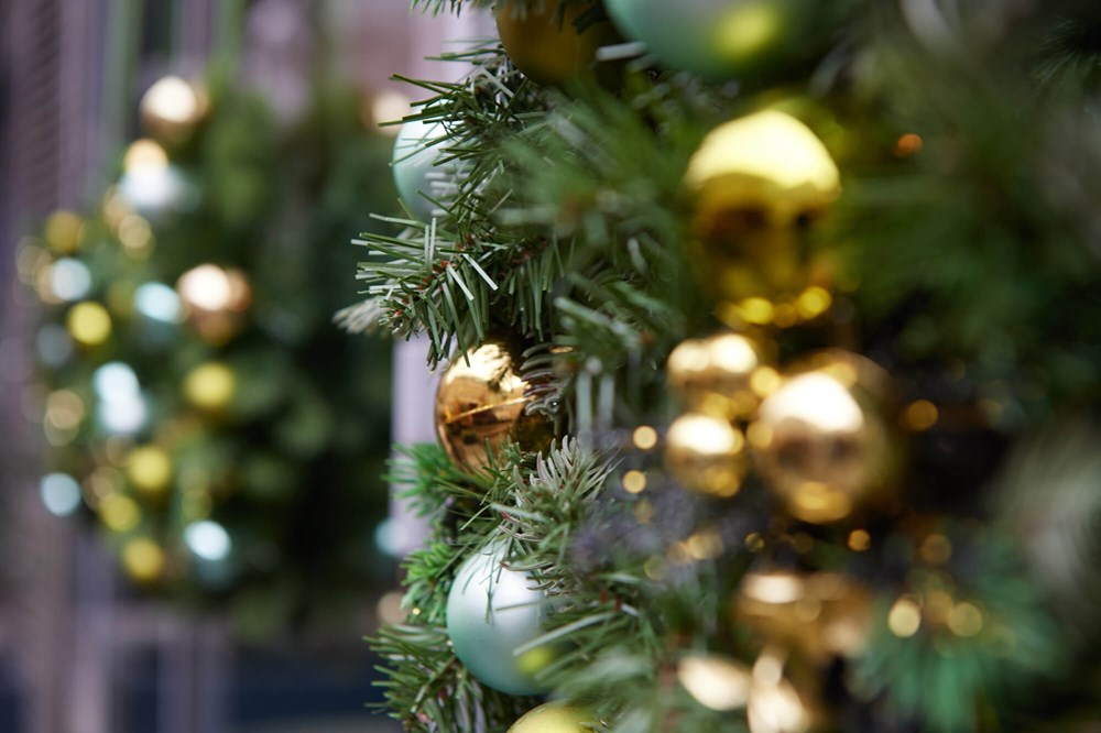 Gold Christmas baubles on wreath