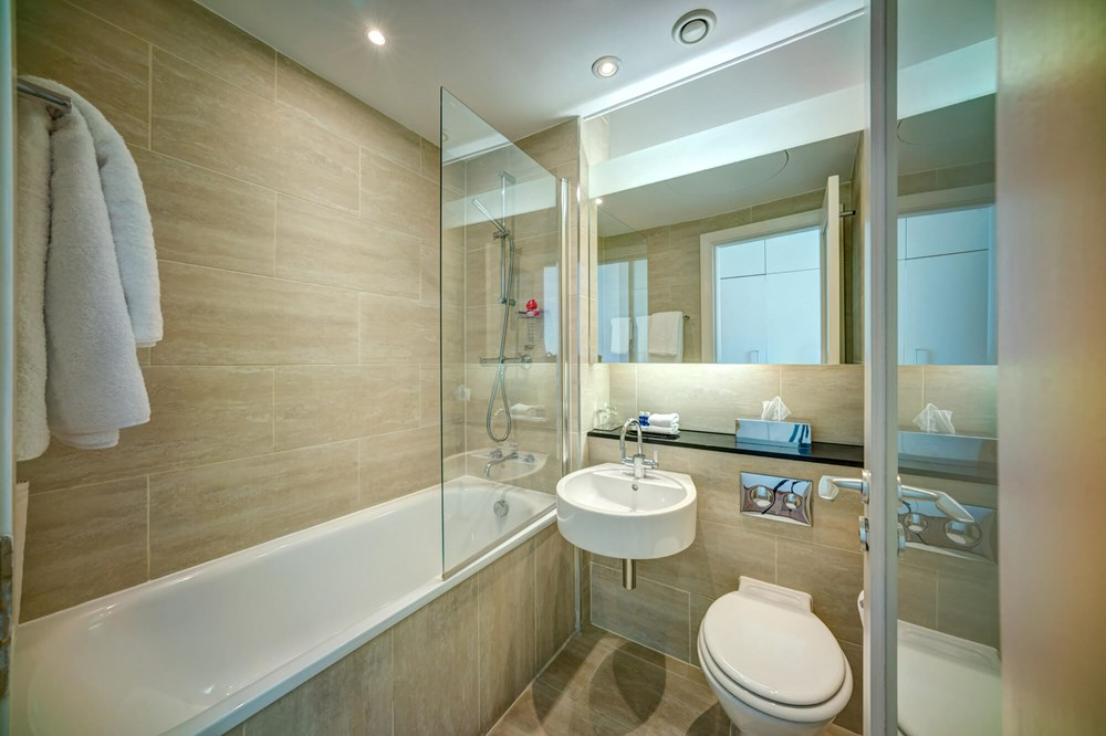 Small City Room bathroom with bath and showerat Apex Haymarket Hotel