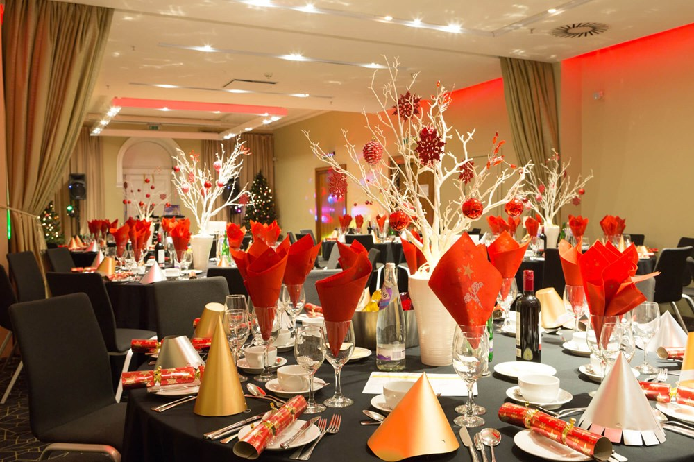 Waterloo Suite set up for Christmas party with festive decor on tables