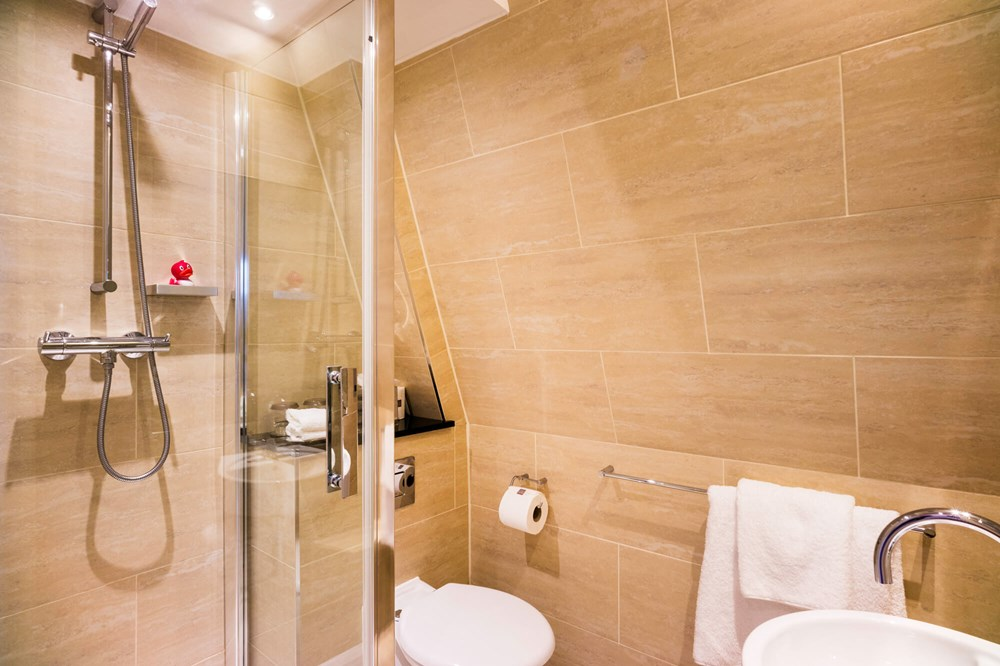 Small City Room shower over bath at Apex Haymarket Hotel