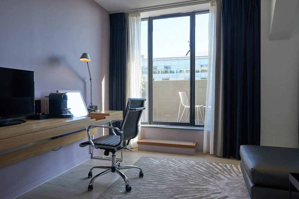 Junior Suite living area with balcony at Apex City of London Hotel