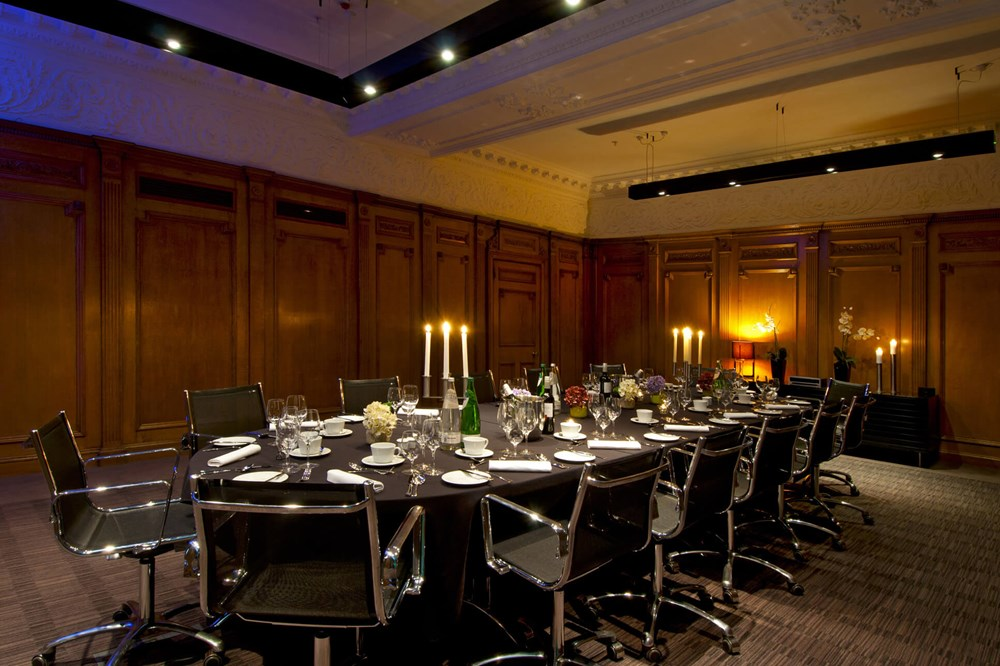 Forth room set for private dining with table and chairs