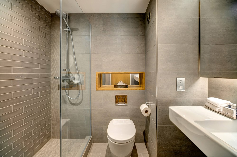 Standard Room bathroom with walk-in shower and sink