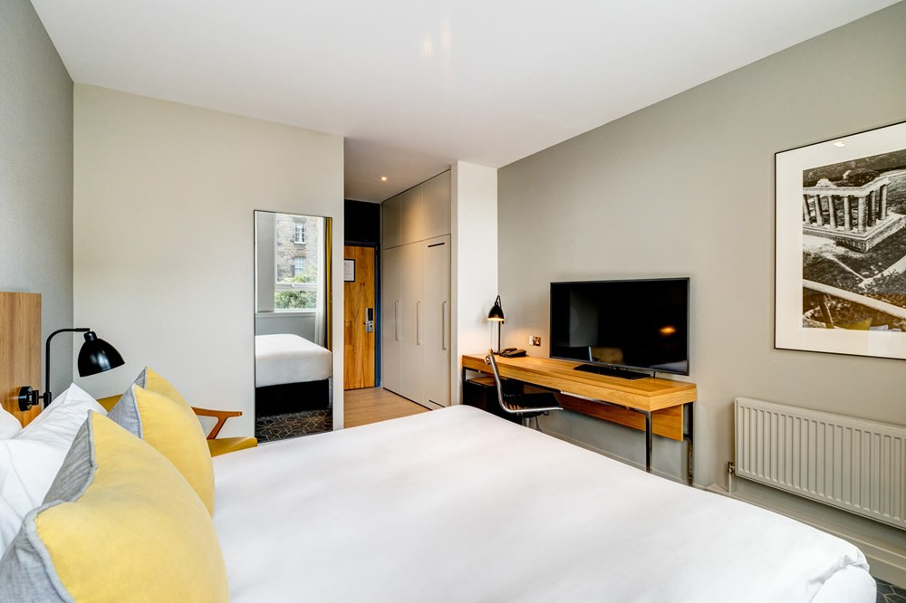 City Room with queen-size bed, desk and TV at Apex Grassmarket Hotel