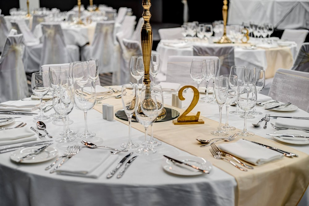 Lansdown Suite set for special occasion with white tablecloths and gold candles
