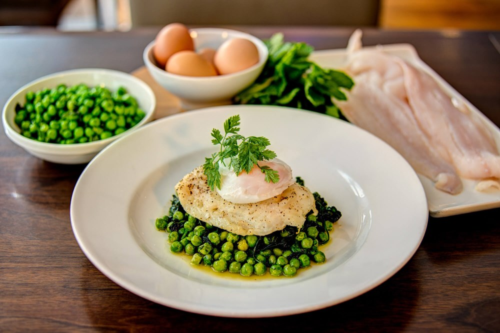 Baked haddock with vegetables at Metro West End