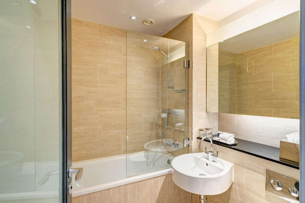 Family Room bathroom with shower over bath at Apex Grassmarket Hotel