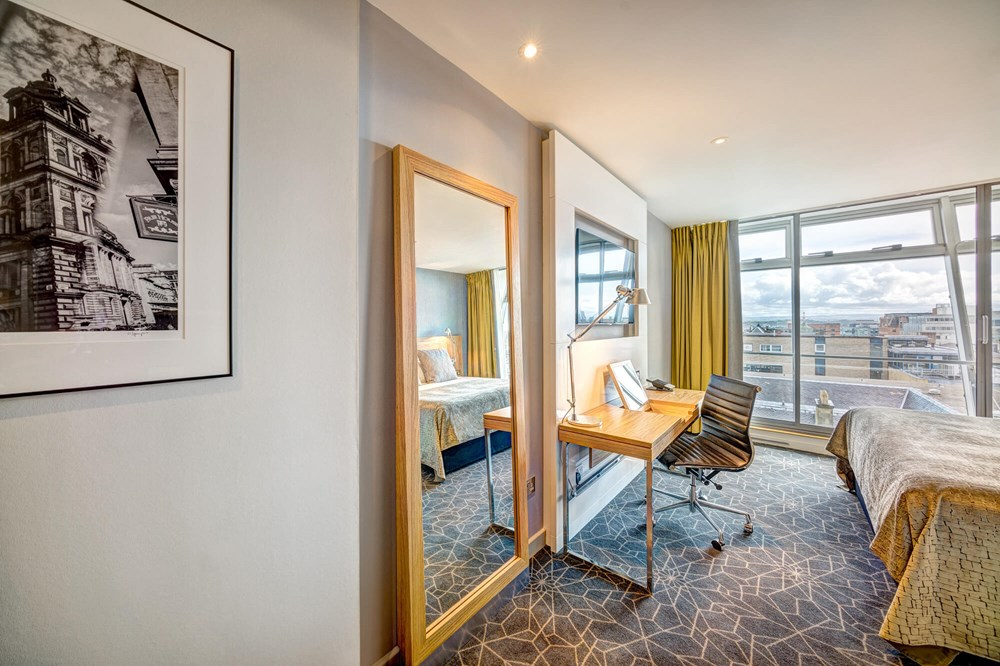City View Room with bed, TV and desk