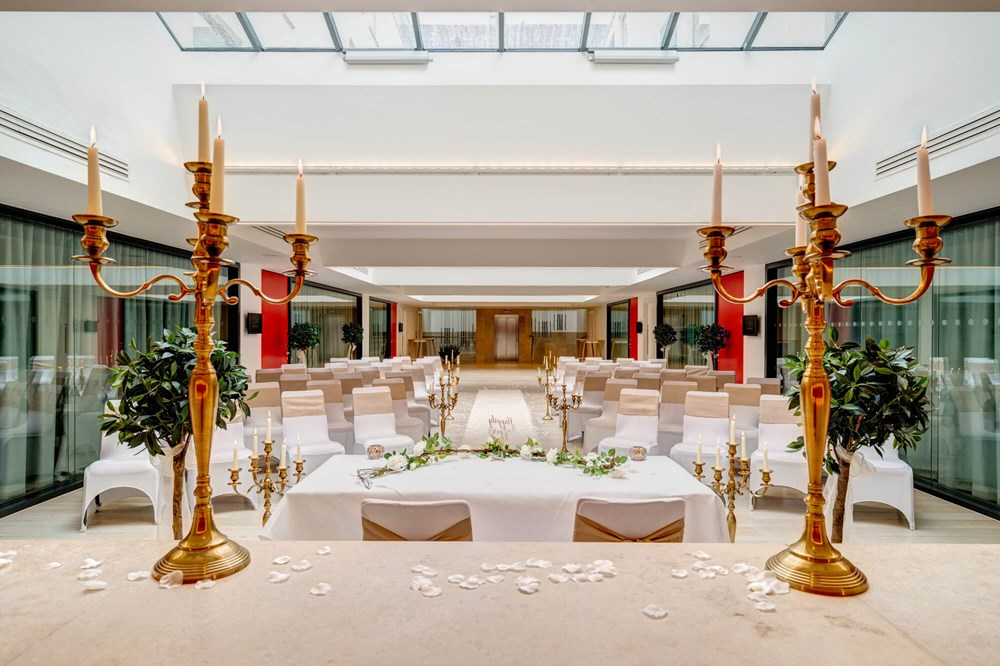 The Atrium set up for wedding with altar and gold candles