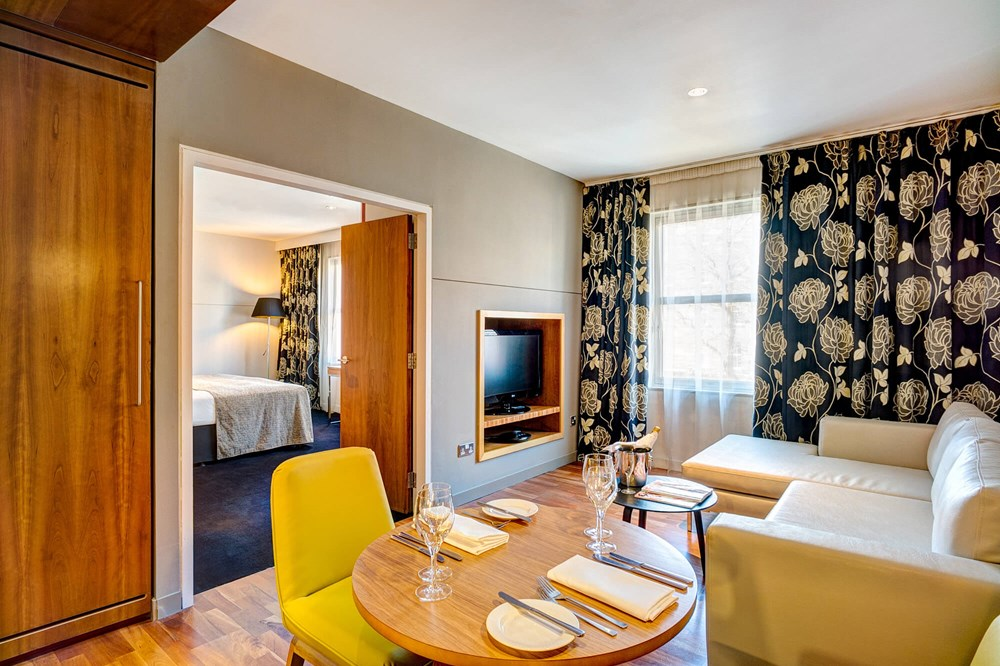 Master Suite living area with sofa and table at Apex City of Edinburgh Hotel