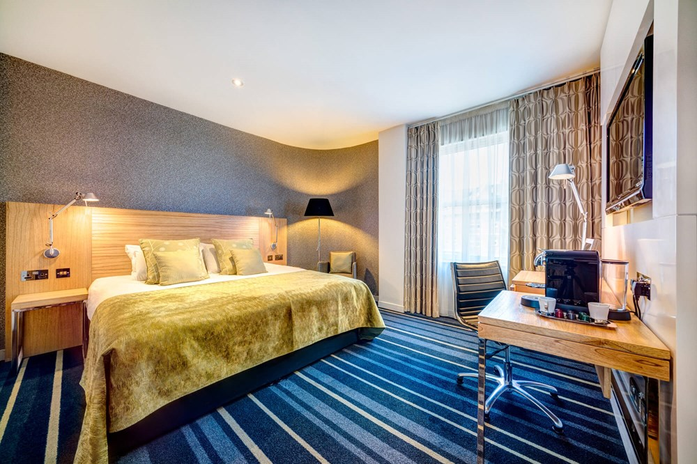 City Plus Room with queen-size bed, desk and Nespresso coffee machine at Apex City of Edinburgh Hotel