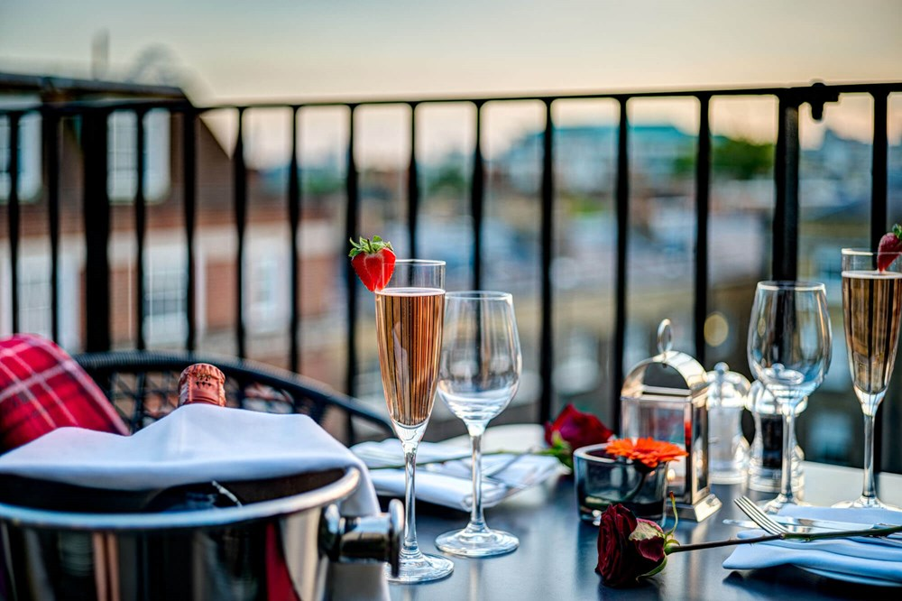 Bottle of Prosecco on balcony at Apex Temple Court Hotel