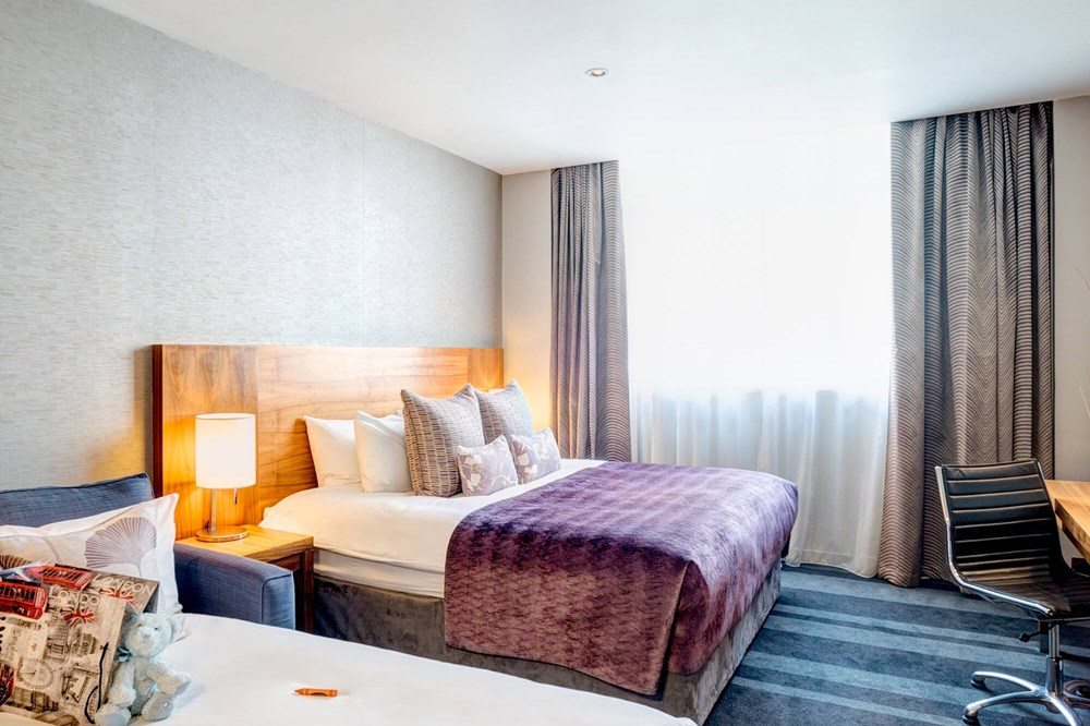 Family Room with king-size bed and sofa bed at Apex City of London Hotel