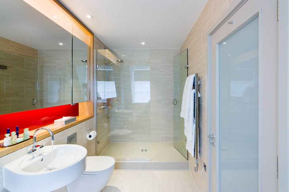Master Suite bathroom with walk-in shower at Apex Temple Court Hotel