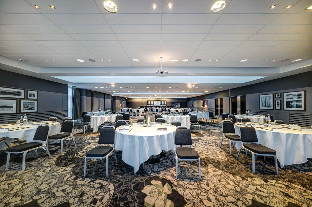 City Quay Suite set up cabaret style with round tables and white tablecloths