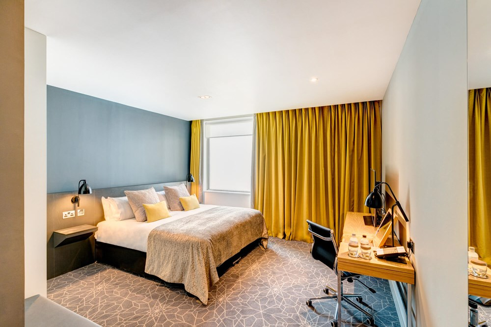 City Room with king-size bed and desk with TV