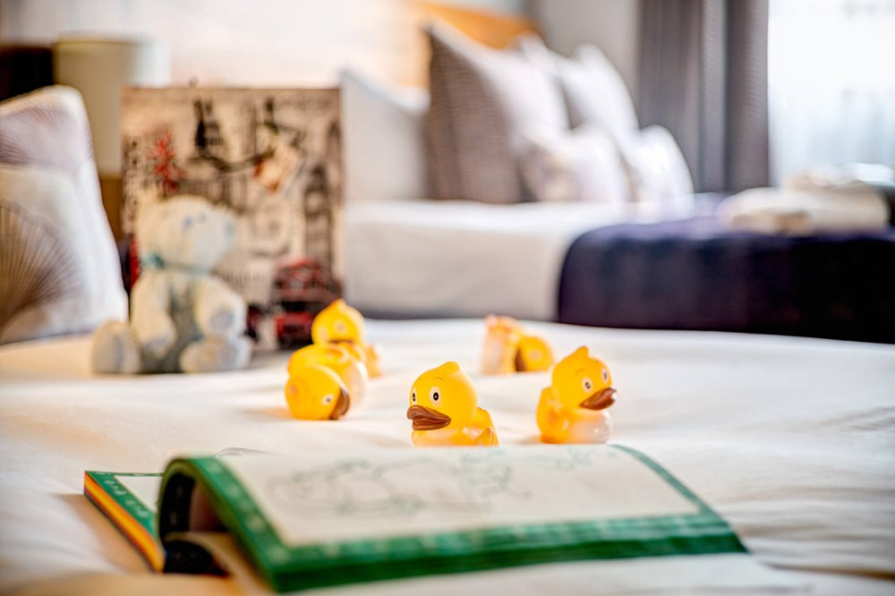 Apex ducks on sofa bed in Family Room at Apex City of London Hotel