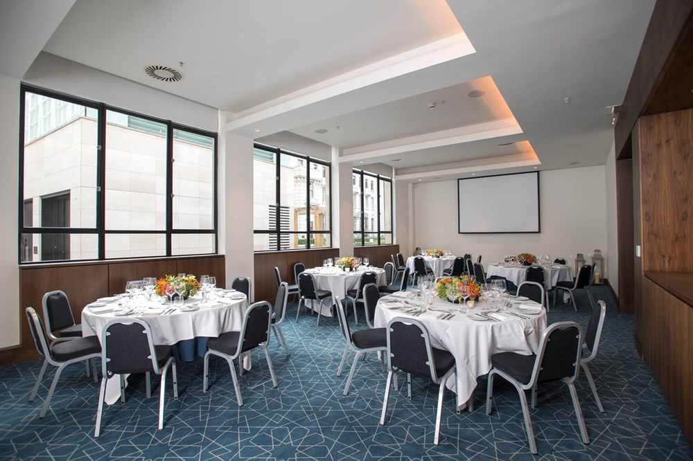 City Suite in Apex City of London Hotel set up for private event with round tables and white tablecloths