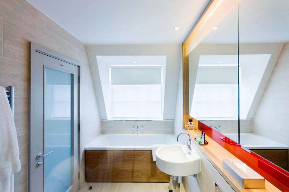Master Suite bathroom with bath at Apex Temple Court Hotel