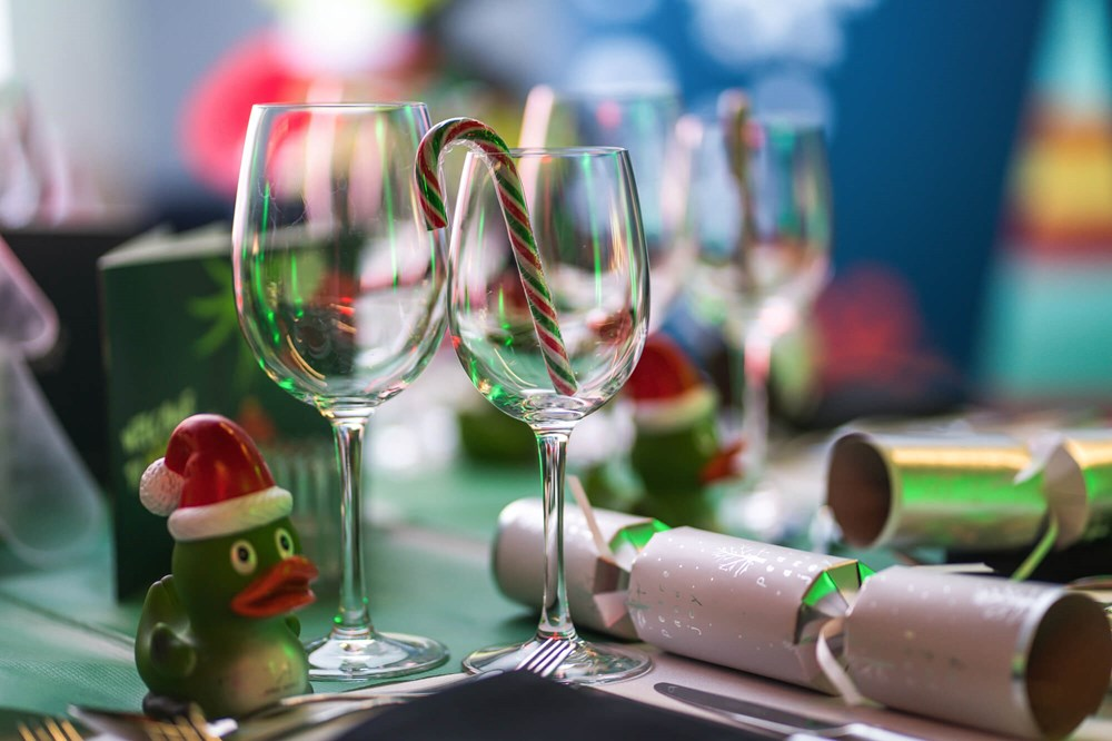 Table set for festive party with Christmas crackers and Apex Sprout duck