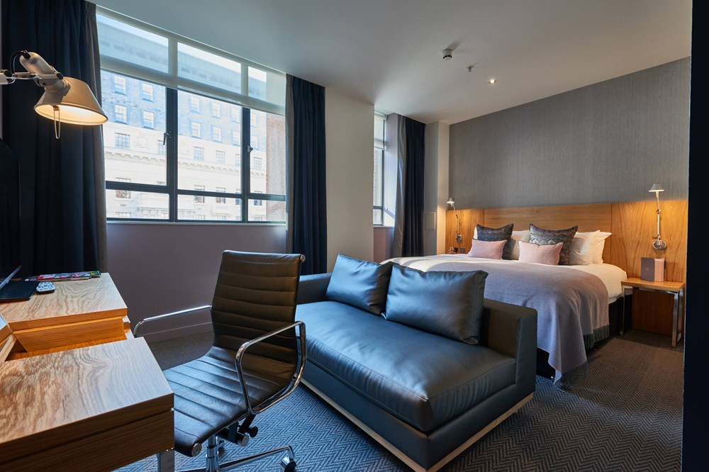 Superior Room with king-size bed, sofa and desk at Apex City of London Hotel