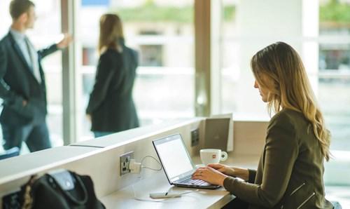 Female business traveller on laptop